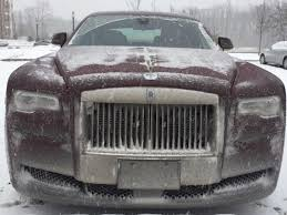 roll royce rollls rolls royce ghost in a snow storm is quite interesting business