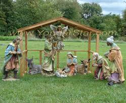 outdoor nativity with wooden stable yonder