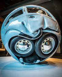cube cars inside vw cars compressed into perfect spheres and cubes by ichwan noor