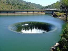 2 meters feet lake hole 70 feet wide drain pipe depth 280 ft 86m u0026 length