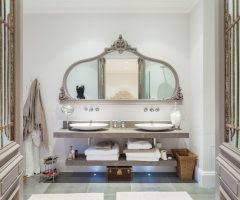 beautiful bathroom pivot mirrors with white counter cabinets