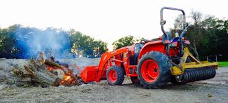 ballast kubota l3560 tractor with la805 loader moving hurricane