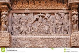 servants and admirers of the indian god on carved wooden wall of