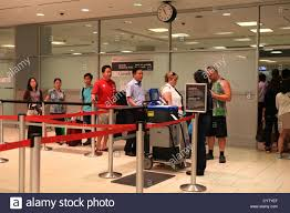 travelers stock images Security officer checking passports of travelers at toronto jpg