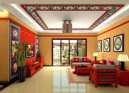 orange home and decor living area wall and false ceiling color paintcoration family