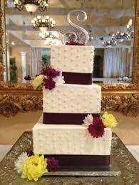 buttercream lace square wedding cake with plum purple ribbon