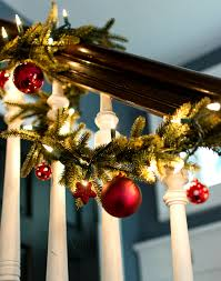 decorating garland with ornaments