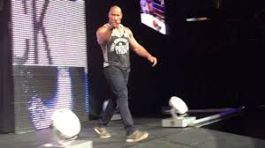 the rock returns to wwe for surprise appearance in boston wwe