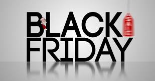 laptop on black friday cyber monday logo on laptop with shopping trolley against black