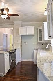 s w cabinets winter haven alaskan white granite and sherwin williams sea salt my remodels