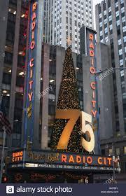 75 year anniversary sign and christmas tree on radio city music