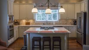 kitchen island with seating consider a kitchen island table angie s list