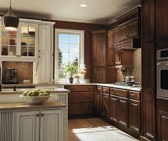 dark maple kitchen cabinets with ivory accents homecrest