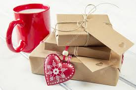 gift wrapped boxes a milk mug for santa a heart and some christmas gift boxes