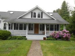 front porch and a frame dormer make this bungalow a real charmer