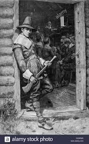 1600s pilgrim standing guard in door of colonial cabin
