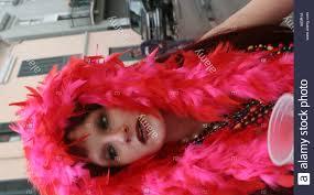 mardi gras feather boas woman in a feather boa at mardi gras stock photo royalty