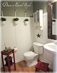 down to earth style board batten bathroom the walls were already painted wethersfield moss by benjamin moore which is a really pretty green there was no trim on the walls so to make this bath look