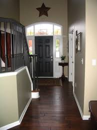 Interior Doors Painted Black by Gray Round Fur Rug On Wooden Floor Hallway Wall Ideas Gray