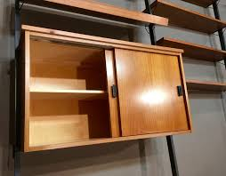 teak and metal modular shelving system with 11 shelves 1950s