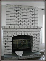 painting black and white brick fireplace brick fireplace black