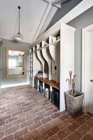 long rustic mudroom features a vaulted ceiling over white mudroom