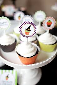 free printable halloween cupcake toppers free halloween printables cupcake monday the tomkat studio blog