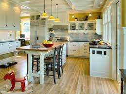 classic kitchen design with white kitchen island wood top black