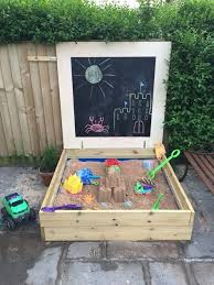 Backyard Sandbox Ideas Homemade Sandpit Using Decking Board And A Blackboard Lid