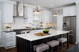 modern kitchen remodel in arlington va dining remodeling in this kitchen remodel features a large central island with ample room for cooking and entertaining the island s dark stained maple cabinets and quartzite