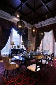 luxury moroccan dining room with dark dining table high ceiling