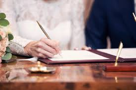 wedding registration list newlyweds put a list in the marriage certficate stock photo