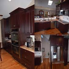 cherry wood kitchen cabinets in cranberry finish with recessed