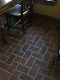 rectangle brown tile kitchen floor plus brown wooden table and