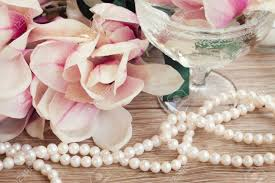 wedding decorations pink magnolia flowers with strand of pearls