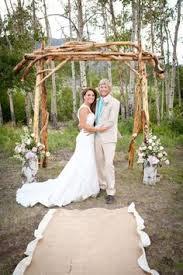 wedding arch log wyoming wedding rustic wedding turquoise log arch cowboy boots