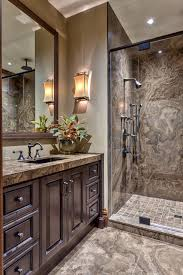 luxurious marble bathroom with glass enclosed shower this bathroom interior designers decorators