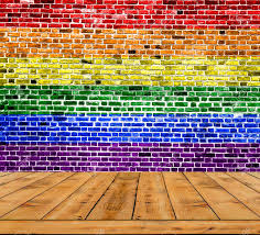 Polyamory Flag Lgbt Flag Painted On Brick Wall With Wooden Floor Stock Photo