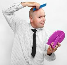 what causes baldness
