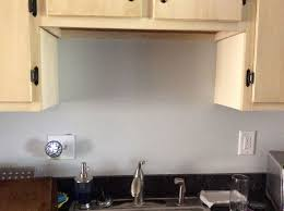 kitchen cabinets above sink what can i do with an akward space above my kitchen sink