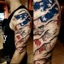 shredded skin with american flag and eagle tattoo by carlos at