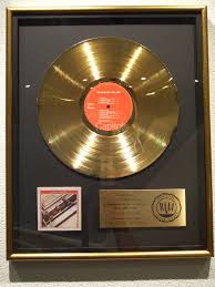 gold photo album the beatles awards and gold records
