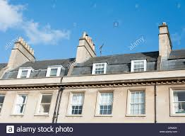 Beige Paint Exterior Mansard Roof With Beige Paint Wall Also Glass Windows