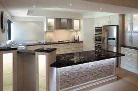 white kitchen cupboards black bench cosmic black granite benchtops with white cupboard fronts