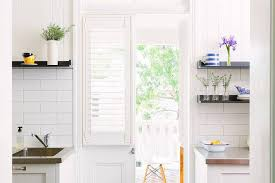 Plantation Shutters For Patio Doors Kitchen Plantation Shutters Traditional Kitchen
