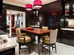 recessed panel kitchen traditional with red pendant lights