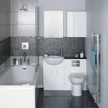 white bath up beside white vanity and sink connected with white