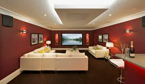 peaceful living room entertainment with black damask wall alluring house theater interior with maroon walls also deep tray ceiling and white furniture set