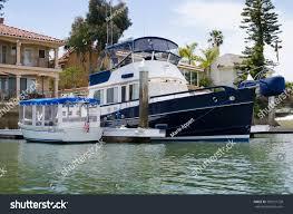beautiful boat moored outside back yard stock photo 189231728
