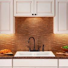 kitchen fasade backsplash and white kitchen cabinets plus wood